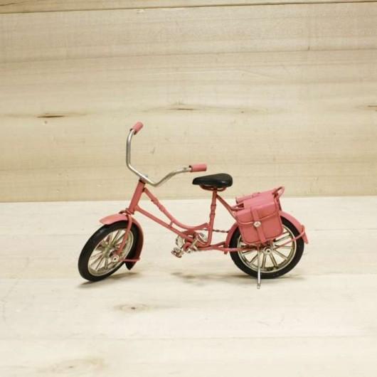 Bicicleta rosa antigua